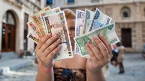 cuba-pesos.si