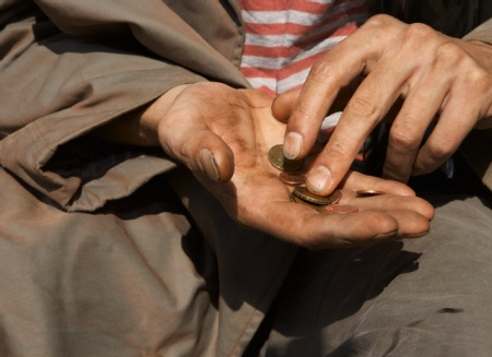 Homeless Man Counting Money