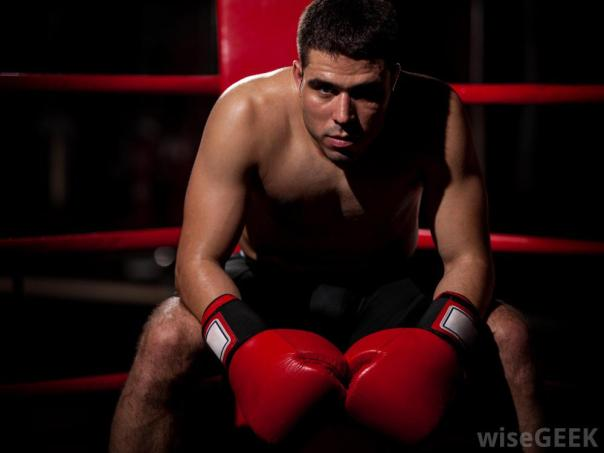 boxer-in-corner-sitting-with-gloves